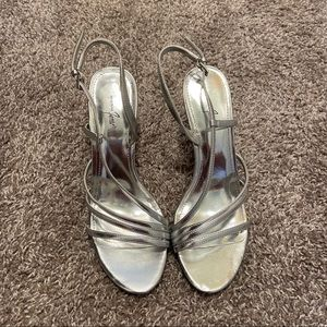 LIKE NEW SILVER FANCY HEELS